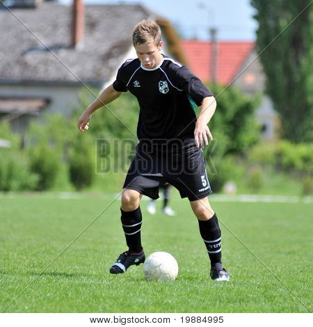 KAPOSVAR, HUNGARY - MAY 29: Andras Strublics (5) in action at the Hungarian National Championship under 19 game between Kaposvari Rakoczi and Barcsi FC May 29, 2010 in Kaposvar, Hungary.