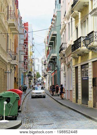 Cobblestone streets of San Juan Puerto Rico - March 9 2017 - People walking the cobblestone streets of San Juan Puerto Rico