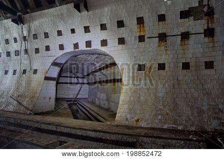 Tiled tunnel in abandoned underground nuclear physics laboratory, Sukhum, Abkhazia