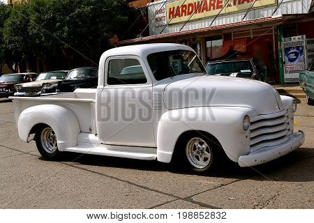 CASSELTON, NORTH DAKOTA, July 27, 2017: The annual Casselton Car Show which occurs the last Thursday of July features classic vehicles such as the restored 1949 white Chevy pickup