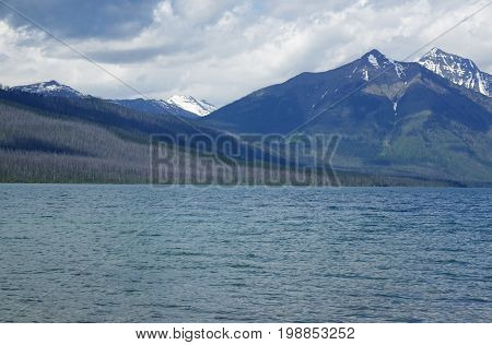 Lake McDonald showing forest-fire burn area on back side of lake (Glacier National Park, Montana.)