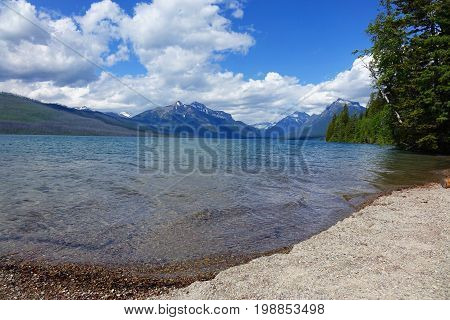 Lake McDonald on a sunny day in Montana's Glacier National Park.