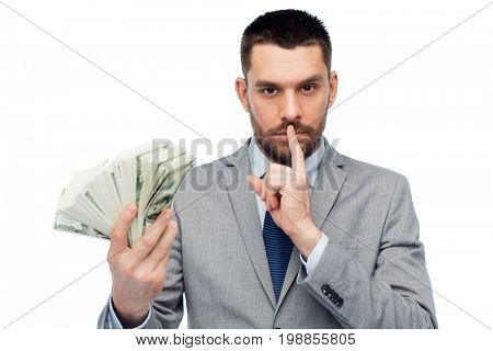 business, people and finances concept - businessman with bundle of american dollar cash money
