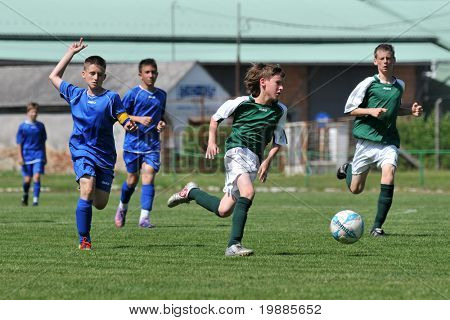 KAPOSVAR, HUNGARY - JUNE 12: Armin Prukner (2nd from R) in action at the Hungarian National Championship under 13 game between Kaposvari Rakoczi and Tatabanya June 12, 2010 in Kaposvar, Hungary.