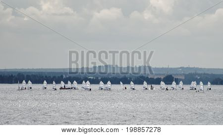 ST. PETERSBURG, RUSSIA - JULY 5, 2017: Children regatta Optimists Of Northern Capital in the Gulf of Finland. This series started in 2012 and sponsored by Gazprom