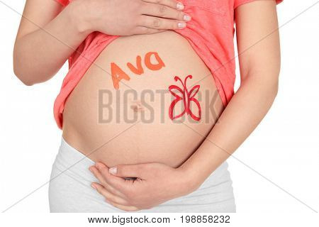 Young pregnant woman with name AVA written on her tummy, closeup. Concept of choosing baby name