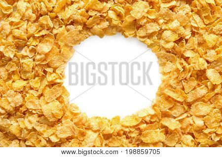 Frame of cornflakes on white background