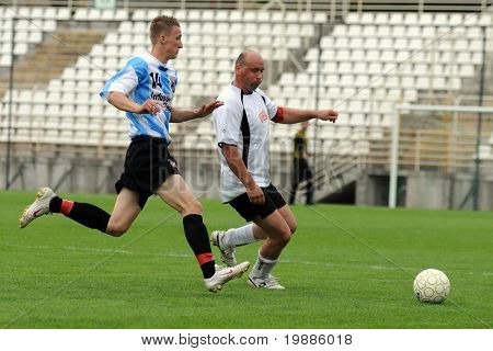 KAPOSVAR, HUNGARY - JUNE 19: Attila Nagy (L) in action at a Somogy County Championship II. final game Balatonszabadi vs. Nemesvid - June 19, 2010 in Kaposvar, Hungary.