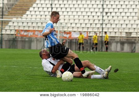 KAPOSVAR, HUNGARY - JUNE 19: Attila Nagy (in blue) in action at a Somogy County Championship II. final game Balatonszabadi vs. Nemesvid - June 19, 2010 in Kaposvar, Hungary.