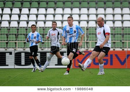 KAPOSVAR, HUNGARY - JUNE 19: Attila Nagy (2nd from R) in action at a Somogy County Championship II. final game Balatonszabadi vs. Nemesvid - June 19, 2010 in Kaposvar, Hungary.