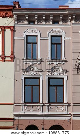 the decorated windows of the ancient building