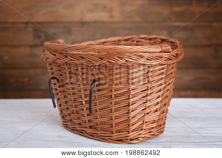 Bicycle wicker basket on wooden table