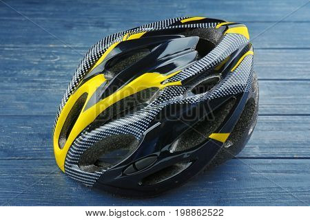 Bicycle helmet on wooden background