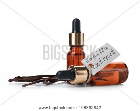 Small bottles with aromatic extract and dry vanilla beans on white background