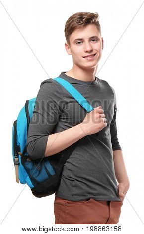 Young teenager boy with knapsack on white background