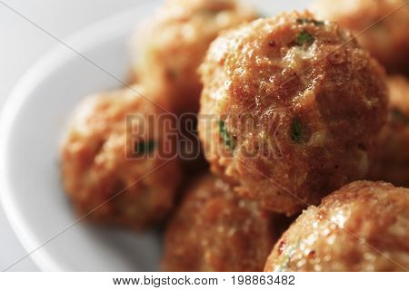 Plate with delicious turkey meatballs, closeup