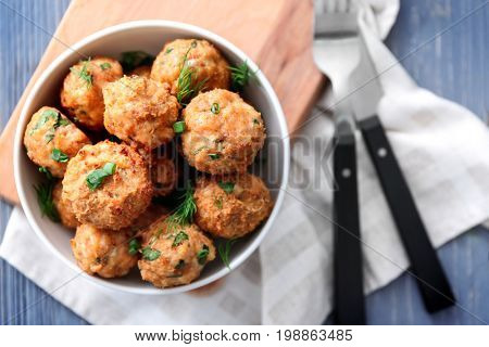Bowl with delicious turkey meatballs on table