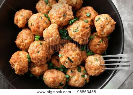 Plate with delicious turkey meatballs on table, closeup