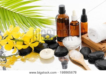 Spa Background with stones ,towel with oil, stones, salt in bowl