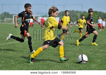 KAPOSVAR, HUNGARY - JULY 19: Unidentified players in action at a VI. Youth Football Festival match Efthymiades FA (CYP) vs. Academia Venezolana de Futbol (VEN)- July 19, 2010 in Kaposvar, Hungary