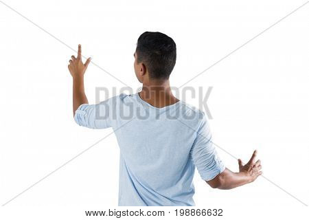 Rear view of man pretending to touch an invisible screen against white background