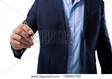 Mid section of businessman pretending to write on invisible screen