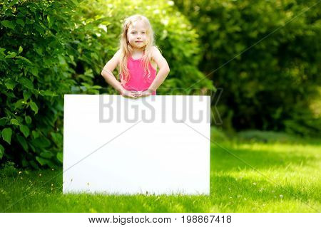 Cute Little Girl Holding Big Blank Whiteboard On Sunny Summer Day Outdoors