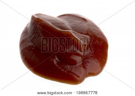 Ketchup blob isolated on white background.