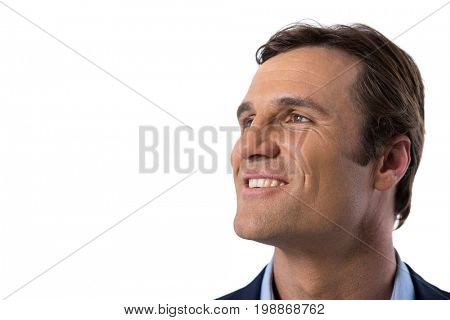 Businessman smiling against white background