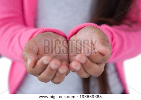 Mid section of girl pretending to be hold invisible object