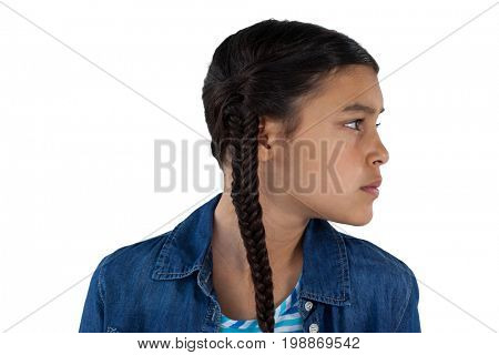 Side view of thoughtful girl standing against white background