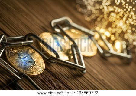 Bitcoin with chain, on wood background