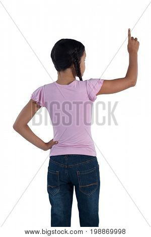 Rear view of girl pretending to touch an invisible screen against white background