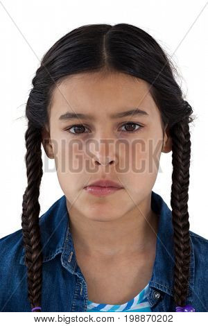 Close-up of sad girl looking down against white background