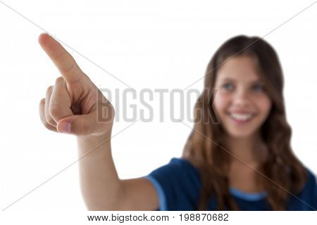 Girl pressing an invisible virtual screen against white background