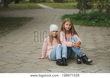 photo of two beautiful girls on the street