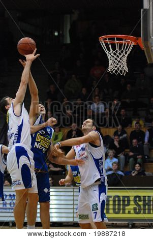 KAPOSVAR, HUNGARY - FEBRUARY 7: Unidentified players in action at a Hugarian Cup basketball game Kaposvar vs. Albacomp February 7, 2007 in Kaposvar, Hungary.
