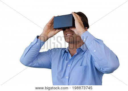 Smiling businessman in blue shirt wearing vr glasses against white background