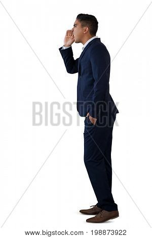 Side view of businessman shouting while standing against white background