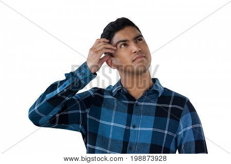 Close up of confused young man against white background