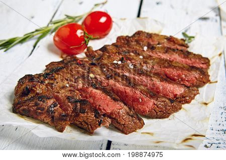 Gourmet Grill Restaurant Beef Steak Menu - Flank Steak on Wooden Background. Beef Steak Dinner