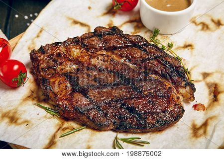 Gourmet Grill Restaurant Steak Menu - Rib Eye Beef Steak on Wooden Background. Black Angus Prime Beef Steak. Beef Steak Dinner