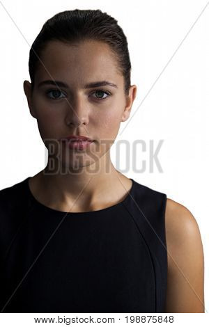 Portrait of young confident businesswoman against white background