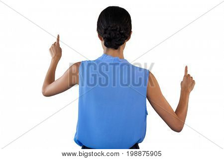 Rear view of businesswoman in sleeveless clothing pointing on interface against white background