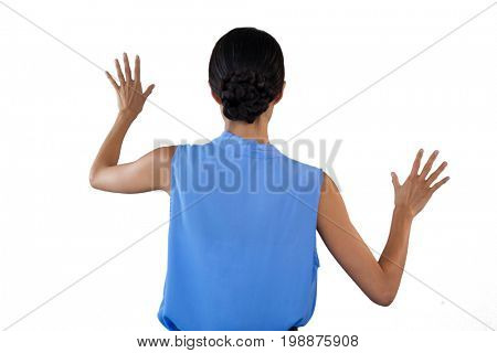 Businesswoman in sleeveless clothing touching interface against white background