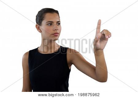 Businesswoman touching invisible interface screen against white background