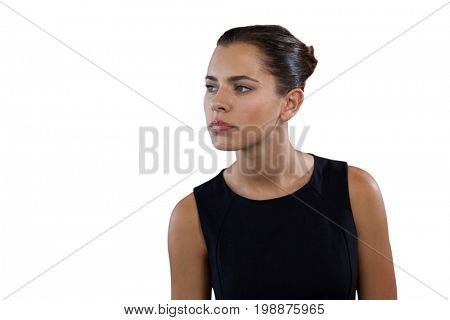 Close up of thoughtful young businesswoman looking away against white background