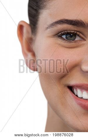 Cropped portrait of happy young woman against white background