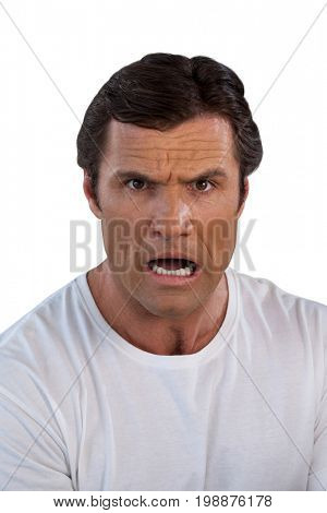 Portrait of shocked mature man against white background