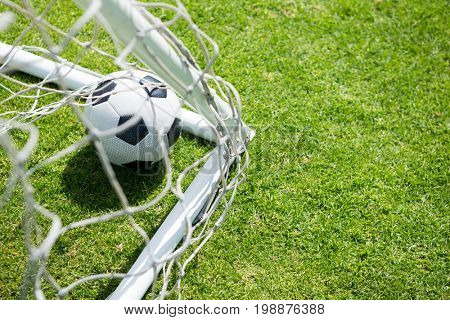 High angle view of soccer ball by goal post at playing field